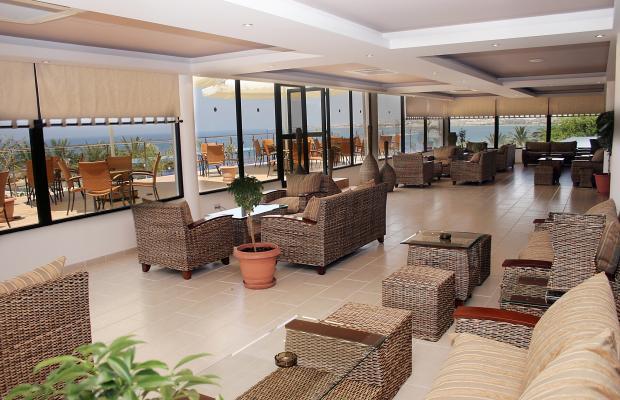 фотографии отеля Queens Bay Hotel изображение №7