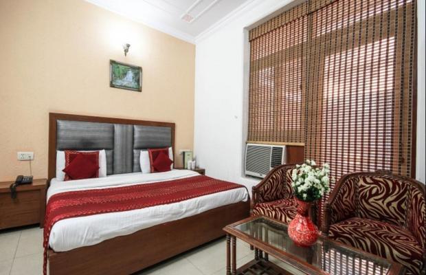фотографии отеля Yuvraj Deluxe изображение №3
